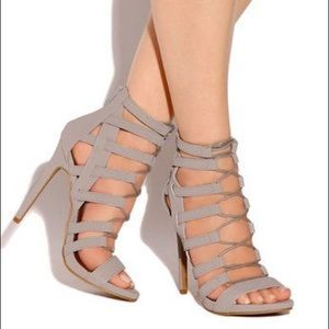Gray strappy lace up heels.